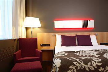 Glo Hotel Sello